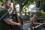 Patrick Williams, left, and his wife, Kara Kesselring, both of Brookfield, trade their own Hollywood neighborhood driveway for a street in Oak Park, where they performed outdoors on Aug. 8 during a block party on Clarence Avenue. (Alex Rogals/Staff Photographer)