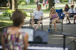 Clarence Avenue residents sit a safe six feet apart while listening to live music performed by Brookfield musicians Patrick Williams and Kara Kesselring on Aug. 8, during a block party in Oak Park. (Alex Rogals/Staff Photographer)