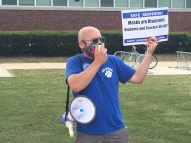 RBHS band director James Baum leads demonstrators in chants calling for fully remote learning to start the 2020-21 school year, prior to the Aug. 11 District 208 school board meeting where a hybrid plan was adopted. | Bob Skolnik/Contributor