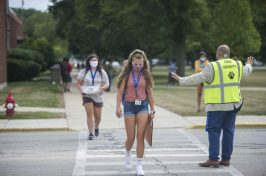 Students wear masks while crossing the street after attending freshman orientation on Aug. 17, at Riverside Brookfield High School. (Alex Rogals/Staff Photographer)
