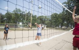 Lilly Luethje bumps the ball over the net on Aug. 24, at Kiwanis Park in Brookfield. (Alex Rogals/Staff Photographer)