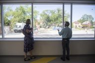 District 96 Superintendent Martha Ryan Toye, left, and Ames Principal Todd Gierman look out from the new windows into the new parking lot on Sept. 2, at A.F. Ames Elementary School in Riverside. (Alex Rogals/Staff Photographer)