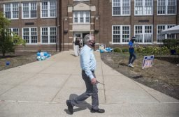 District 96 Principal Todd Gierman walks outside to greet families on the first day of classes, Sept. 2, at A.F. Ames Elementary School in Riverside. (Alex Rogals/Staff Photographer)