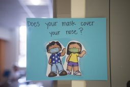 Mask signs outside of classrooms reminded Ames School students to wear face coverings while inside the building. (Alex Rogals/Staff Photographer)