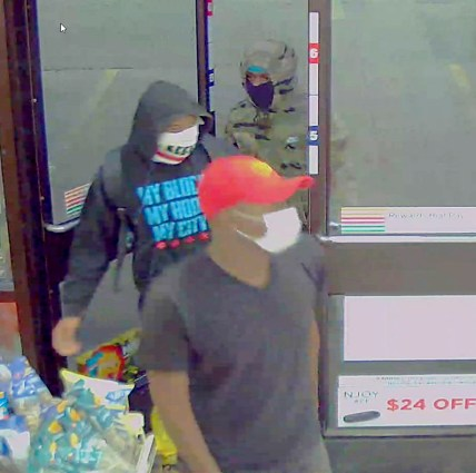 Riverside police have arrested the alleged ringleader (wearing red hat) of a robbery crew that reportedly held up a Riverside 7-Eleven on Sept. 5 and at least a half dozen other businesses in Chicago and the suburbs. (Photo courtesy of the Riverside Police Department)