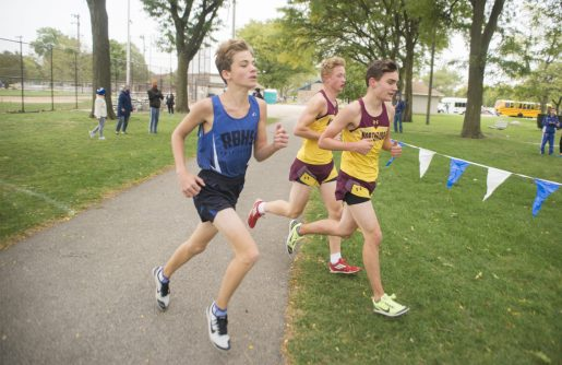 A runner for the RBHS varsity boys cross country team competes on Oct. 3, during the senior celebration meet against Northridge Prep at Elhert Park in Brookfield. (Alex Rogals/Staff Photographer)