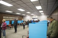 The lines outside Brookfield Village Hall continued inside the polling place in the council chamber, where voters cast their ballots on 12 touchscreen machines during the first day of early voting on Oct. 19. (Alex Rogals/Staff Photographer)