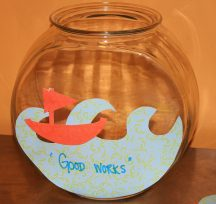 "Our ""Good Works"" fish bowl we are filling up throughout Lent with our fish notes of good things we did during the day: Sticking up for a classmate, smiling at someone who looks anxious, donating to a local charity, shopping local."