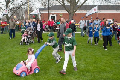 Little Leaguers, their coaches and family members, march onto Roy A. Overholt Field for the Brookfield Little League parade that opens the baseball season.