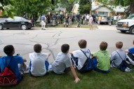 """Boys line a curb across from 262 Longcommon Road in hopes of watching a film crew """"blow up"""" a car for an episode of """"Betrayal."""""""