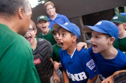 North Riverside manager LaFonzo Palmer leads his team, the Green Lanterns, in a cheer before they took the field Thursday to battle LaGrange Park in the Overholt Baseball Tournament in Brookfield.