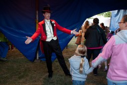 Ringmaster John Moss III greets people as they leave the big top.