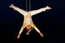 Aerialist Girard Portugal really lets go of the bar in his head balancing trapeze act.