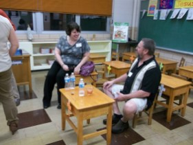 Donna Houdek, Class of 1980, chats with Rob Leake, having a bottle of water or three, and a mixed drink. Oooh, what would the nuns say? Photo by Chris Stach.