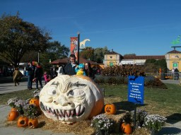 A family poses near the zoo's 1,793 pound Great Pumpkin. (photo courtesy of Chris Stach)
