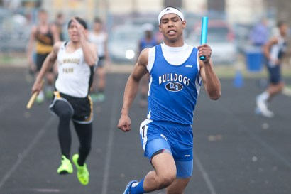 Riverside-Brookfield's Gerrand Moody, right, sprints to the finish running the anchor leg of the Bulldogs' 4 X 100-meter relay team during the 47th annual Gary Johnson Bulldog Relays. (David Pierini/staff photographer)