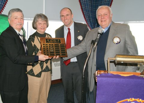 Riverside Township Lions Club member Jack Wiaduck (right) presents Ann and Steve Kubiczky (at left) with the Bill Jansky Distinguished Citizen Award plaque while club President Joe Dvorak looks on. The award honors township residents who have demonstrated a strong commitment to volunteerism and service to the community.