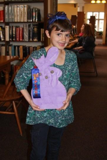 Jane McNamara holds her award for winning the RAC's Peeps diorama contest.
