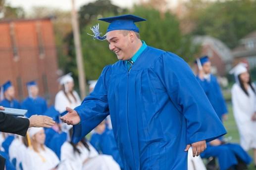 Christopher Gorniak smiles as he walks up to receive his diploma. (David Pierini/staff photographer)