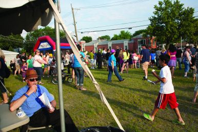 Hundreds gathered for free popcorn, cupcakes, ice cream, a magic show and live music.