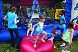 Kids were treated to free turns in a bounce house.