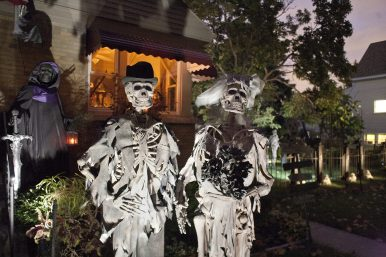 DAVID PIERINI/Staff Photographer Happily Buried: This lovely newlywed couple greets visitors to Ken Novitski's Brookfield home, which is elaborately decorated for Halloween.