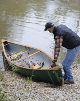 Jon Platt, of Brookfield, used his canoe Saturday to gather garbage that was tossed into Salt Creek during the village's annual Project NICE campaign, which beautifies and cleans up parks and other public areas. (Photo by Jennifer Wolfe)