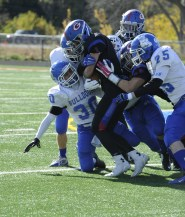 RBHS senior safety Adolfo Linares, #30, tackles a Glenbard South runner during Saturday's 31-7 loss in Glen Ellyn. (Photo by Jennifer Wolfe)
