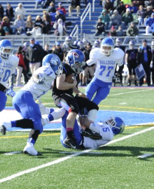 RBHS defensive back Zach Witken, #5, hauls down a Glenbard South offensive player during the Raiders; 31-7 victory over the Bulldogs in the Class 6A playoffs. (Photo by Jennifer Wolfe)
