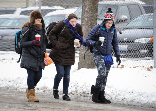 Riverside Brookfield High School's students: Left to right Hannah Ranft (jr), Abby Schwartz (jr), Margaret Miezio (sr) walks to school in the frigid temperatures on Thursday morning. | Jennifer Wolfe/contributor