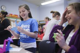 From left) Fifth-graders Hannah Organ and Giuliana Speziale make origami cranes during Brook Park Elementary School's Annual Cultural Week, on Friday, January 30, 2015. | (Chandler West/Staff Photographer)