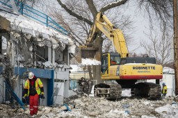 A blizzard only delayed the start of demolition by a day. On Feb. 3, a wrecking crew began taking down Shuey Statium at Riverside-Brookfield High School. By the end of the week, it was gone. | Chandler West/Staff Photographer