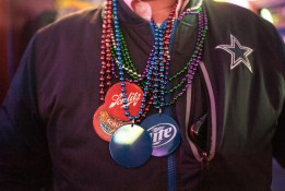 Beads cover a Dallas Cowboy jackets during the yearly celebration of Mardi Gras Pub Craw in Brookfield on February 14. | William Camargo: Contributing photographer