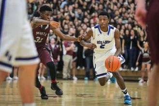 RBHS sophomore guard Jalen Clanton, right, dribbles the ball up court against Morton senior Dexter Dale. Clanton scored 15 points in the Bulldogs' 66-61 win. (Chandler West/Staff Photographer)