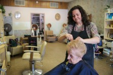 Lisa Meyer cuts the hair of long-time customer Joan Liepe, on Thursday, March 26, 2015. Meyer is celebrating 30 years in her business.   CHANDLER WEST/Staff Photographer