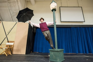 I'm happy again: Don Lockwood (Gerald Kelel) sings and dances through the title tune of Singin' in the Rain during a rehearsal on Monday at the Village Commons gym in North Riverside | Max Herman/Contributing Photographer