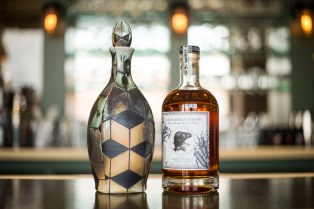 A handmade bourbon bottle, created by David Bolton, which will be part of an art exhibition at Quincy Street Distillery later this month.| CHANDLER WEST/Staff Photographer