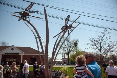 """Taking flight: """"Prairie Spirit"""" (left) is a new sculpture by Paul Russell (below) and sponsored by the Brookfield Beautification Commission, which held a ceremony May 2 dedicating the work to the late Al Kitzer, the village's former public works director and resident volunteer whose family maintained the location where the sculpture stands as part of the commission's Adopt-A-Spot program. 