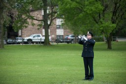 "Officer Winfrey of the Park Forest Police Departments plays ""Taps"" after the 14th Annual Memorial Ceremony honoring peace officers killed in the line of duty. The Ceremony took place at the proposed site of a Cook County Peace Officers Memorial in Lyons, IL on Saturday May 9, 2015. 