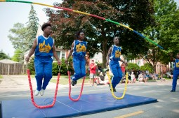 The Chicago Boyz Acrobatic team participate in the annual 4th of July parade in Brookfield on July 4, 2015. Weather was enjoyable and candy was thrown out to children who attended the parade.