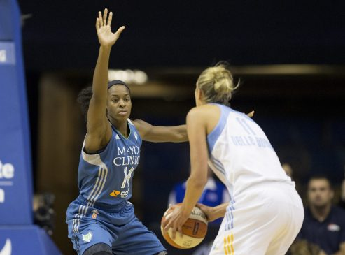 Minnesota Lynx forward Devereaux Peters defends Chicago Sky star/WNBA leading scorer Elena Delle Donne during a WNBA game at Allstate Arena on July 10. Peters played high school basketball at Fenwick, leading the Friars to the 2007 state title. (Ting Shen/Contributing Photographer)