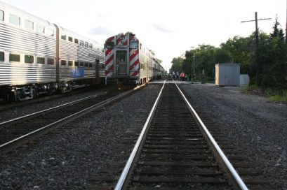 Police investigate the scene of a fatal crash Tuesday involving a Metra express train (center track) and a bicyclist wearing headphones who rode around a stopped train on the evening of July 14 at Harlem Avenue in Riverside. (Photo courtesy of the Riverside Police Department)