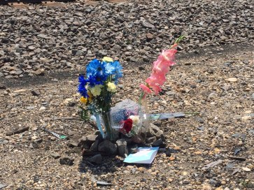 Relatives on Wednesday, July 15 erected this small memorial to Jose Arguello near the scene of his death, just west of Harlem Avenue along the BNSF railroad tracks. Throughout the day relatives and friends could be seen visiting the site.