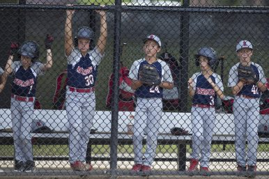 (Left to right) Riverside players Ryan O'Donoghue, Alec Posluzny, Ryan Novak, Jake O'Brien and Rex Dockendorf intently watch the action on the field during the 10-Under Illinois Little League State Tournament at Keystone Park in River Forest. (Contributing Photographer Ting Shen)