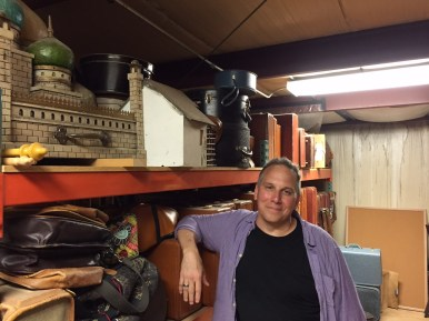 Stephen Kolack standing in one of the storerooms for props. | Bob Uphues/Staff