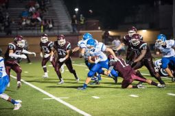 RBHS running back Jeremiah Clarkson breaks through the line of scrimmage against Morton in the season opener on August 28, 2015. (Max Herman/Contributing Photographer)