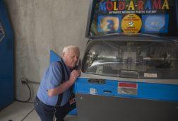 William Jones looks into the Mold-A-Rama machine near the dolphin show area at Brookfield Zoo. | William Camargo/Staff Photographer