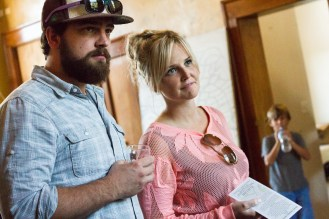 Andy Ohlrich, left, of The Leadfoot Band, and his wife Carley Ohlrich, right, listen to a representative from the Quincy Street Distillery talk about their product. | Stacey Rupolo/Contributor
