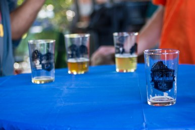 Commemmorative glasses line a table. Vendors included BuckleDown Brewing, Goose Island, Brickstone Brewing, Pollyanna Brewing, Revolution Brewing, and Blue Nose Brewery with food provided by the Boo Coo Roux food truck and The Amazing Kale Burger. | Stacey Rupolo/Contributor