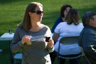 Kelly Ashline waits for a friend at the HopStop beer festival. | Stacey Rupolo/Contributor